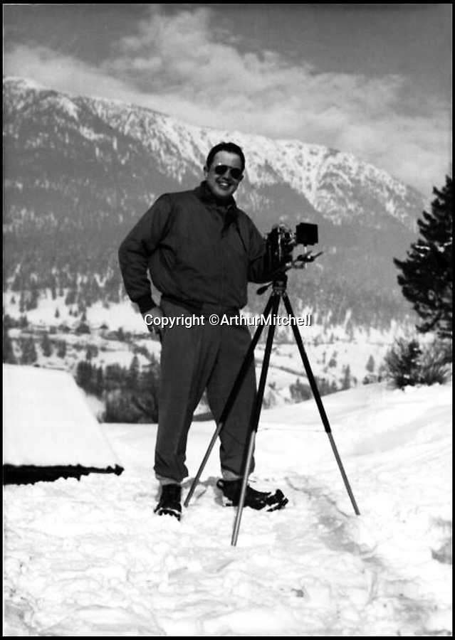 BNPS.co.uk (01202 558833)Pic: ArthurMitchell/BNPS<br /> <br /> Captain George J Mitchell, Jr US Army Counter Intelligence Corps. Pictured in the Alps (1951).<br /> <br /> A poster for the 1931 horror movie Dracula that was gifted to a young film buff 70 years ago has been sold by his family for a world record £400,000.<br /> <br /> The 41ins by 27ins advert is described as the 'holy grail' of movie posters and is just one of two left in the world.<br /> <br /> It belonged the late George Mitchell jr whose son, Arthur, hung it on the back of his bedroom door for several years as a child.<br /> <br /> After Arthur's parents died he and his brother James inherited the Dracula poster.