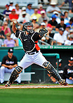 13 March 2012: Miami Marlins catcher John Buck in action during a Spring Training game against the Atlanta Braves at Roger Dean Stadium in Jupiter, Florida. The two teams battled to a 2-2 tie playing 10 innings of Grapefruit League action. Mandatory Credit: Ed Wolfstein Photo