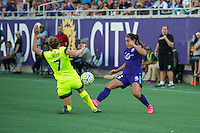 Orlando, Florida - Sunday, May 8, 2016: Orlando Pride midfielder Samantha Witteman (26) and Seattle Reign FC defender Elli Reed (7) challenge for a ball during a National Women's Soccer League match between Orlando Pride and Seattle Reign FC at Camping World Stadium.