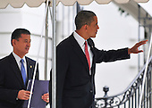 United States President Barack Obama, followed by Secretary for Veterans Affairs Eric Shinseki,  departs the South Lawn of the White House in Washington, D.C. on Monday, August 3, 2010.  The President is traveling to Atlanta, Georgia to speak at the national convention of Disabled American Veterans. .Credit: Ron Sachs / Pool via CNP