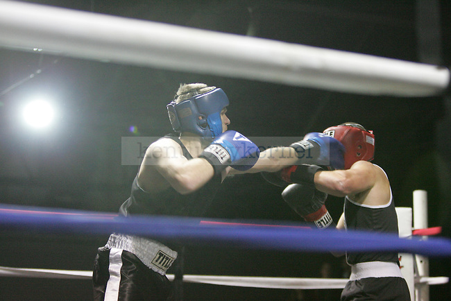Clinton Egnor (L) of Triangle punches Ben Tofante (R) of Pike during their bout at The Main Event, where proceeds benefitted The Huntsman Cancer Institute and The Ronald McDonald House in Lexington, Ky. on 11/11/11. Photo by Quianna Lige | Staff