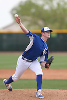 Carter Hope #56 of the Kansas City Royals pitches during a Minor League Spring Training Game against the Texas Rangers at the Kansas City Royals Spring Training Complex on March 20, 2014 in Surprise, Arizona. (Larry Goren/Four Seam Images)