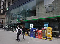 Toronto (ON) CANADA,  April , 2008-..Newspaper boxes bside TD building on Queen street....