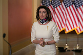 """Speaker of the United States House of Representatives Nancy Pelosi (Democrat of California), arrives at a news conference to deliver a statement on Capitol Hill, in Washington D.C., Tuesday, May 12, 2020, on the Heroes Act aid package introduced by House democrats. The legislation provides nearly $1 trillion for states and cities, and """"hazard pay"""" for essential workers affected by the Coronavirus pandemic.<br /> Credit: Graeme Jennings / CNP"""