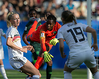 GRENOBLE, FRANCE - JUNE 22: Chiamaka Nnadozie #16 of the Nigerian National Team punches out a cross during a game between Nigeria and Germany at Stade des Alpes on June 22, 2019 in Grenoble, France.