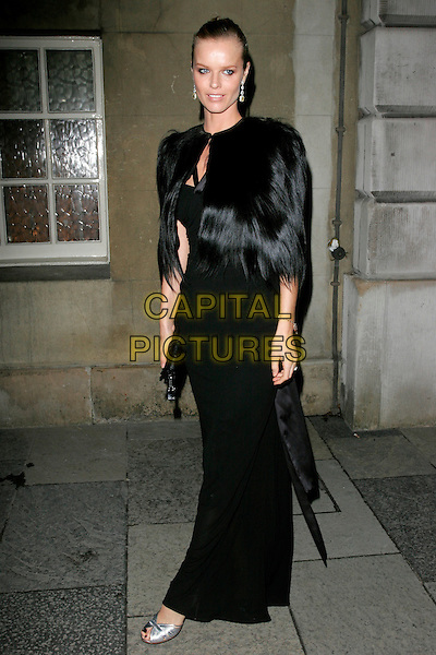 EVA HERZIGOVA .Chaos Point, in aid of NSPCC at the Banqueting House, London, England..November 18th, 2008 .full length black fur coat jacket clutch bag dress long cape wrap.CAP/AH.©Adam Houghton/Capital Pictures.