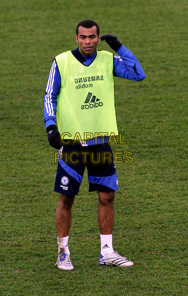 ASHLEY COLE.At Chelsea training ground, Cobham, Surrey, England..March 14th, 2008.full length sport football soccer kit uniform blue short fluorescent vest top gloves.CAP/DH.©David Hitchens/Capital Pictures.