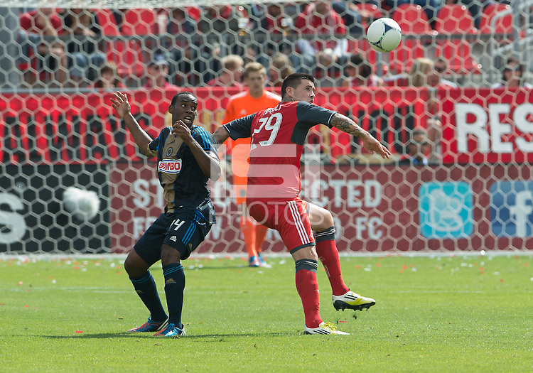 15 September 2012: Philadelphia Union midfielder Amobi Okugo #14 and Toronto FC forward Eric Hassli #29 in action during an MLS game between the Philadelphia Union and Toronto FC at BMO Field in Toronto, Ontario Canada. .The game ended in a 1-1 draw.