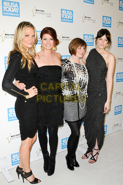MOLLY SIMS, DEBRA MESSING, KATE ROBERTS & MANDY MOORE.at the USA Today 4th Annual Hollywood Hero Award Honors at the Montage Beverly Hills in Beverly Hills, California, USA, November 10th 2009..full length  one shoulder black and white dress long maxi tiered strapless tights grey gray top skirt print pearl necklace pearls ruffle sleeved sleeves long gold zips sandals peep toe hand on hip polka dot .CAP/ROT.©Lee Roth/Capital Pictures