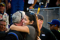 Actress Angie Harmon greets friend and Johnson spoter Earl Barban in victory lane.