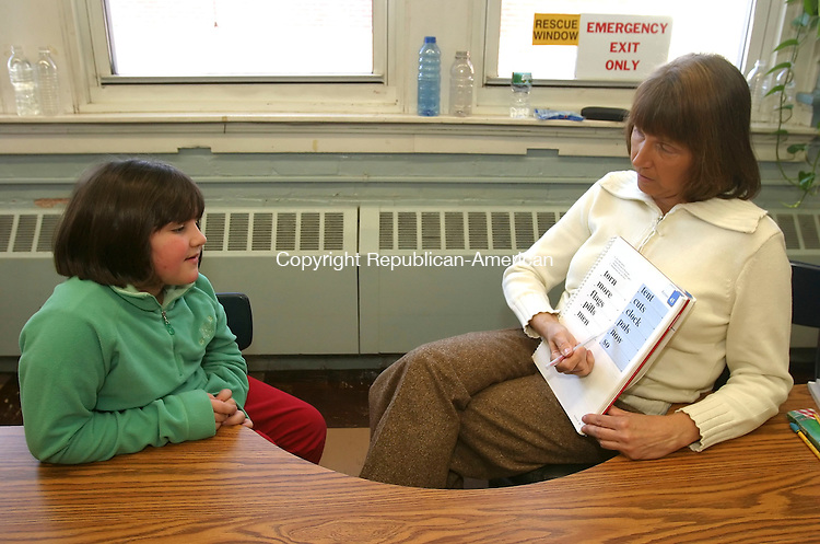 PLYMOUTH, CT 01/16/08- 011608BZ03- Mikayla Kennedy, 8, gr. 3, works on &quot;Word Attack Strategies&quot; with Carolyn Celantano, Title 1 Reading Tutor, at Main Street School in Plymouth Wednesday morning.<br /> Jamison C. Bazinet Republican-American