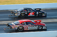Jul. 1, 2012; Joliet, IL, USA: NHRA pro stock driver Erica Enders (far) defeats V. Gaines during the Route 66 Nationals at Route 66 Raceway. Mandatory Credit: Mark J. Rebilas-