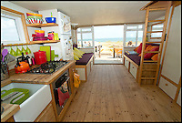 BNPS.co.uk (01202 558833)<br /> Pic: LauraDale/BNPS<br /> <br /> A modest beach hut with no bathroom or mains electricity has gone on the market for a whopping 270,000 pounds - making it the most expensive in Britain.<br /> <br /> The asking price for the tiny wooden shack on Mudeford Spit near Christchurch, Dorset, is the same cost as a plush three-bedroom house in some parts of the country and is as much as a top-of-the-range Ferrari car.<br /> <br /> The 18ft by 12ft hut can sleep up to 12 people - four people on a mezzanine deck, four on two sofa beds and another two on a pull-out bed.<br /> <br /> The huge asking price is because it is just a stones throw away from the water boasting stunning sea views out towards the Isle of Wight and the Needles.<br /> <br /> The current owners are selling the beach hut so that they can move to another one on the same sandy strip with a different view.