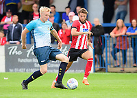 Gainsborough Trinity's Nathan Stainfield under pressure from Lincoln City's Jorge Grant<br /> <br /> Photographer Chris Vaughan/CameraSport<br /> <br /> Football Pre-Season Friendly (Community Festival of Lincolnshire) - Gainsborough Trinity v Lincoln City - Saturday 6th July 2019 - The Martin & Co Arena - Gainsborough<br /> <br /> World Copyright © 2018 CameraSport. All rights reserved. 43 Linden Ave. Countesthorpe. Leicester. England. LE8 5PG - Tel: +44 (0) 116 277 4147 - admin@camerasport.com - www.camerasport.com