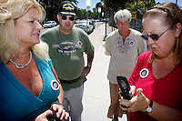 San Diego, CA, Saturday, September 06 2008:  Friends of Rosa Lisowski wear buttons with the missing woman's image on them before a press conference at Barnard Elementary School to comment on the arrest of her husband, Henry.   Lisowski was arrested at his home in Ocean Beach last Friday night.  Rosa Lisowski has not been seen since she dropped her son off at the Barnard Elemtary school on the morning of Monday March 24 2008.  From left, Heather Peterson, Arthur Eischens, Cheryl Eischens, Janet Boyd.