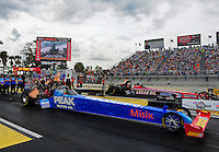Mar. 9, 2012; Gainesville, FL, USA; NHRA top fuel dragster driver T.J. Zizzo (near) races alongside Chris Karamesines during qualifying for the Gatornationals at Auto Plus Raceway at Gainesville. Mandatory Credit: Mark J. Rebilas-