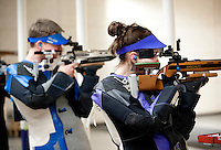 Sarah Beard (cq, right), with the Texas Christian University Women's Rifle Team, shoots next to Pat Everson (cq) of the Air Force Academy during a qualifying shooting match at the TCU campus in Ft. Worth, Texas, Saturday, February 12, 2011. The TCU team is undefeated this season and won the national championship last year to become the first all women's team to win the championship...CREDIT: Matt Nager for The Wall Street Journal
