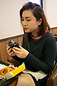 A woman eats a &quot;kuro burger&quot; or &quot;black burgers&quot; at Burger King restaurant on September 19, 2014 in Tokyo, Japan. Burger King launches to its menu two kinds of black burgers &quot;Kuro Diamond&quot; and &quot;Kuro Pearl&quot; which contains black buns and black cheese made from bamboo charcoal, garlic sauce made with squid ink and beef patties made with black pepper all in black color starting on Friday, September 19 for a limit period. The Kuro Diamond priced at 690 JPY <br /> (6.35 USD) and the Kuro Pearl which cost at 480 JPY (4.42 USD). The last year Burger King included the &quot;Ninja Burger&quot; similar black burger on its Japanese menu. (Photo by Rodrigo Reyes Marin/AFLO)
