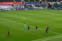 Luton Town players take to the pitch during the Sky Bet Championship match between Swansea City and Luton Town at the Liberty Stadium in Swansea, Wales, UK. Saturday 27 June 2020.