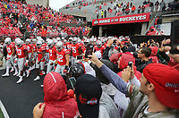 Fans take photos as Ohio State Buckeyes take the field for warm-up prior to the NCAA football game between Ohio State and Rutgers at Ohio Stadium on Saturday, September 8, 2018.  [Jonathan Quilter/Dispatch]