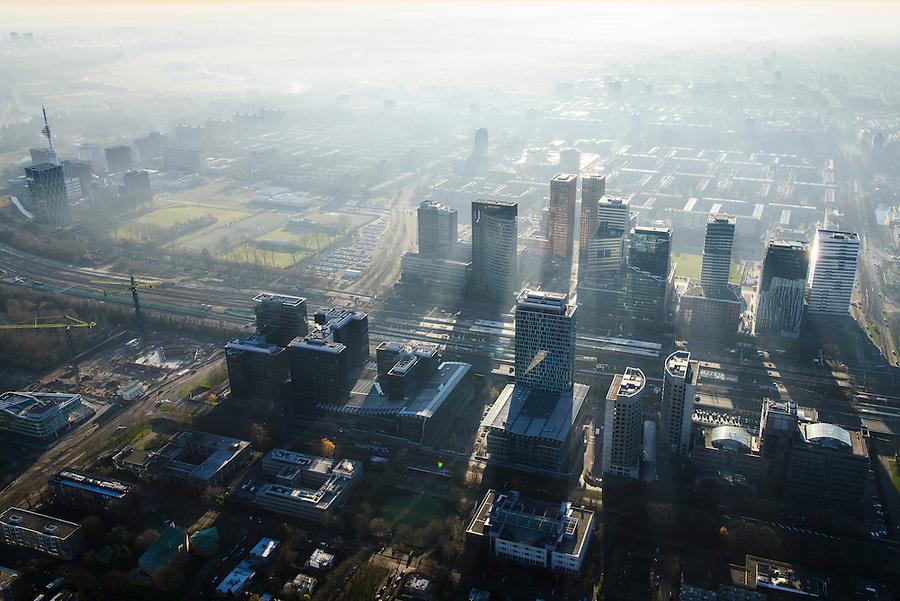 Nederland, Noord-Holland, Amsterdam, 11-12-2013; zicht op de Zuidas met in het midden Station Zuid-WTC, World Trade Centre (WTC) en Ring A10, foto richting Buitenveldert. Verder in beeld hoofdkantoor ABN-AMRO, de woontorens Symphony 1 en 2 (onderdeel Gershwin), de Vinoly-toren en Ito-toren (onderdeel Mahler4), Atrium.<br /> Zuid-as, 'South axis', financial center in the South of Amsterdam, with headquarters of former ABN AMRO. Amsterdam equivalent of 'the City', financial district. <br /> luchtfoto (toeslag op standaard tarieven);<br /> aerial photo (additional fee required);<br /> copyright foto/photo Siebe Swart.