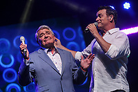 Michel Louvain and Roch Voisine perform at the Festival d'ete de Quebec (FEQ) in Quebec city Wednesday July 12, 2017.