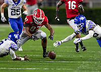 ATHENS, GA - OCTOBER 19: Tyler Simmons #87 of the Georgia Bulldogs and Brandin Echols #26 of the Kentucky Wildcats dive for the fumble that was recovered by Echols during a game between University of Kentucky Wildcats and University of Georgia Bulldogs at Sanford Stadium on October 19, 2019 in Athens, Georgia.