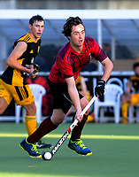 Action from the Wellington Hockey men's open grade premier one match between Dalefield (black and gold) and Hutt United (red) at National Hockey Stadium in Wellington, New Zealand on Saturday, 26 May 2018. Photo: Dave Lintott / lintottphoto.co.nz