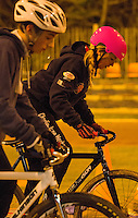 31 MAR 2015 - IPSWICH, GBR - Charlie-Jane Herbert (right) starts her next drill during an Ipswich Cycle Speedway Club training session at Whitton Sports and Community Centre in Ipswich, Great Britain (PHOTO COPYRIGHT © 2015 NIGEL FARROW, ALL RIGHTS RESERVED)