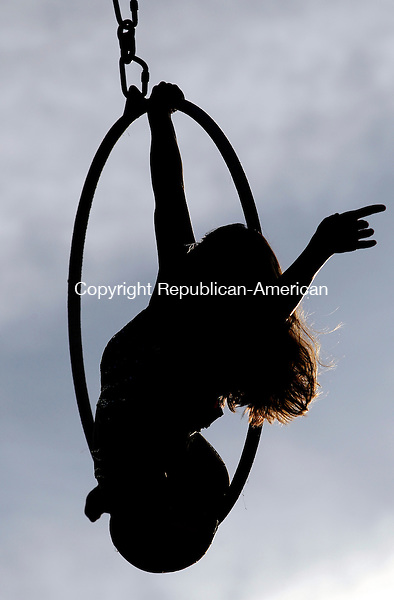 Oxford, CT-02, July 2010-070210CM10  Rosie Eastman, of Cristiani Brothers and Reid Imperial Circus, performs an acrobatics routine Friday night at the Quaker Farms Fire Company Carnival.  --Christopher Massa Republican-American