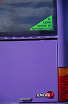 AT5BX4 A low emission bus sticker on the back window of a purple Excel park and ride bus