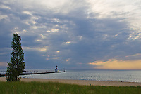 St. Joseph, Michigan's Pierhead Lights sit ona pier on the shore of Lake Michigan at Sunset, Berrien County, Michigan