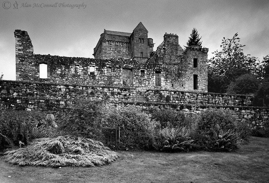 Castle Campbell is a medieval castle ruins originally built in the mid 1400's.  Colin Campbell, 1st Earl of Argyll, acquired the castle around 1460.  Castle Campbell sits on a beautiful hill above the town of Dollar, Clackmannanshire, in central Scotland.  To get to the main gate, one needs to drive up a long and very narrow road to the small parking area.  From there, you make a pleasant walk about 500 m down a steep and up to the castle.