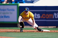 Michigan Wolverines first baseman Jesse Franklin (7) stretches for a throw during a game against Army West Point on February 17, 2018 at Tradition Field in St. Lucie, Florida.  Army defeated Michigan 4-3.  (Mike Janes/Four Seam Images)