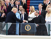 President  Donald J. Trump shakes hands with Chief Justice John Roberts after taking the Oath of Office at his inauguration on January 20, 2017 in Washington, D.C.  Trump became the 45th President of the United States.       <br /> Credit: Pat Benic / Pool via CNP