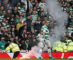 Celtic fans throw a flare on the pitch