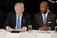 United States President Donald Trump as Kenneth Frazier Chairman and CEO, Merck looks on during a  listening session with manufacturing CEOs  in the State Dining Room  of the White House on February 23, 2017 in Washington, DC. Photo Credit: Olivier Douliery/CNP/AdMedia