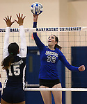 Marymount's Emily Shultis dinks in a college volleyball match against PSU Harrisburg at Marymount University in Arlington, Vir., on Wednesday, Oct. 9, 2013.<br /> Photo by Cathleen Allison