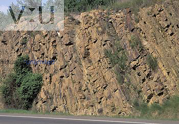 Tilted layers or strata of Pennsylvanian Age Atoka Formation Shale in a road cut, USA.