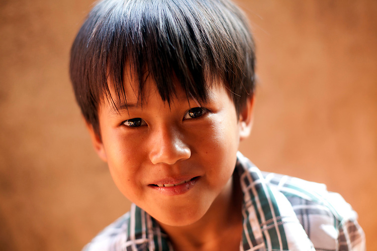 Portrait of a young Cambodian boy in a village outside of Phnom Penh, Cambodia. <br /> <br /> Photos &copy; Dennis Drenner 2013.
