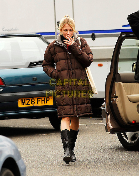"MICHELLE WILLIAMS.Filming ""Incenidary"" at Waterloo Place, Pall Mall, London, England, May 5th 2007..full length brown puffa jacket coat black boots on set film mini skirt car door.CAP/IA.©Ian Allis/Capital Pictures"