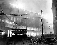 A burning building in Sheffield which was raided recently.  December 1941.  New Times Paris Bureau Collection.  (USIA)<br /> Exact Date Shot Unknown<br /> NARA FILE #:  306-NT-901C-7<br /> WAR &amp; CONFLICT BOOK #:  1005