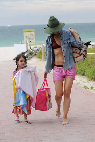 MIAMI BEACH , FL - JUNE 18: Katie Holmes and Suri Cruise are sighted with an unknown woman on June 18, 2011 in Miami Beach, Florida. ( photo by Mpi04/MediaPunch Inc.)