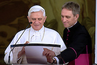 Pope Benedict XVI Monsignor Georg Gänswein private secretaryblesses the faithful during his Sunday Angelus address in his summer residence in Castel Gandolfo on the outskirts of Rome, Sunday July 6, 2008.