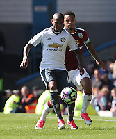 Manchester United's Ashley Young and Burnley's Andre Gray<br /> <br /> Photographer Rachel Holborn/CameraSport<br /> <br /> The Premier League - Burnley v Manchester United - Sunday 23rd April 2017 - Turf Moor - Burnley<br /> <br /> World Copyright &copy; 2017 CameraSport. All rights reserved. 43 Linden Ave. Countesthorpe. Leicester. England. LE8 5PG - Tel: +44 (0) 116 277 4147 - admin@camerasport.com - www.camerasport.com