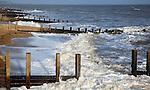 Wooden groynes and waves, Felixstowe, Suffolk, England