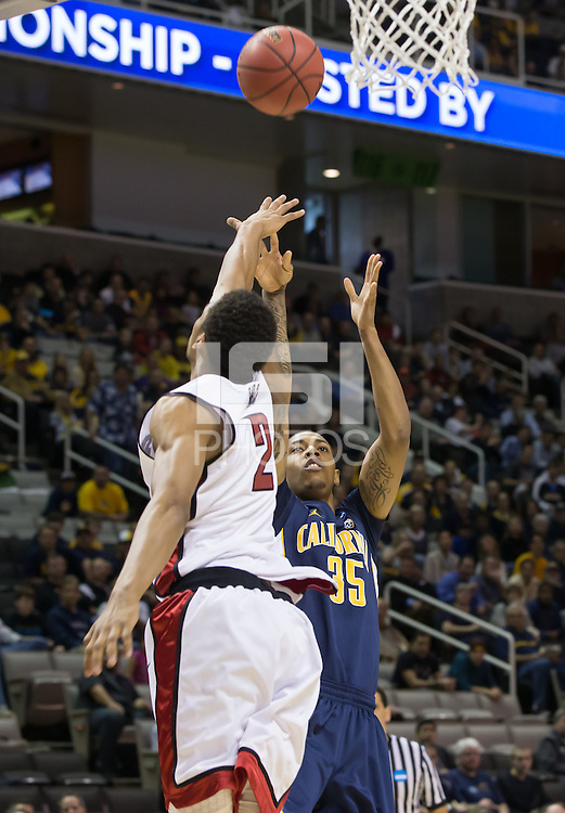 March 21st, 2013: California's Richard Solomon shoots for the basket and is being defended by UNLV's Khem Birch during a game at HP Pavilion, San Jose, California. California defeated UNLV 64 - 61