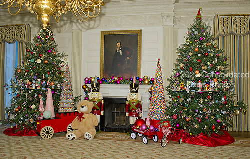 Decorations in the State Dining Room surround the portrait of former United States President Abraham Lincoln on the State Floor as part of the 2015 White House Christmas theme &quot;A Timeless Tradition&quot; at the White House in Washington, DC on Wednesday, December 2, 2015.  The decorations include a six foot teddy bear and hundreds of vintage nutcrackers.<br /> Credit: Ron Sachs / CNP