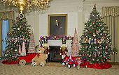 """Decorations in the State Dining Room surround the portrait of former United States President Abraham Lincoln on the State Floor as part of the 2015 White House Christmas theme """"A Timeless Tradition"""" at the White House in Washington, DC on Wednesday, December 2, 2015.  The decorations include a six foot teddy bear and hundreds of vintage nutcrackers.<br /> Credit: Ron Sachs / CNP"""