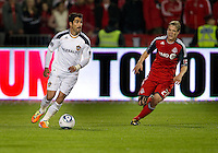 13 April 2011: Los Angeles Galaxy forward Juan Pablo Angel #9 and Toronto FC defender Ty Harden #20 in action during an MLS game between Los Angeles Galaxy and the Toronto FC at BMO Field in Toronto, Ontario Canada..The game ended in a 0-0 draw.